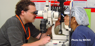 NIOSH optometrist conducting an eye exam on a poultry-processing worker