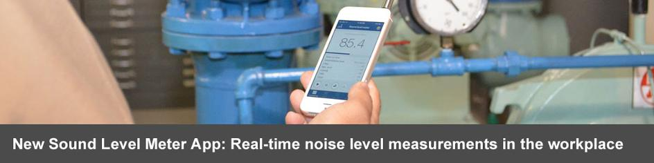 Close up of worker holding smartphone and using new NIOSH Sound level meter app, showing 85.4 decibels