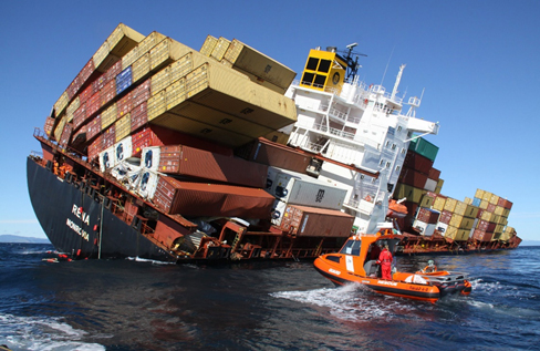 M/V Rena sits partially capsized after running aground on a reef near New Zealand. Image credit: iStock/Getty Images Plus