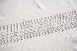 Fresh snow sedan tire track