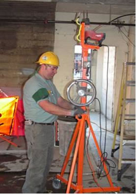 The photo on the left shows a typical method for overhead drilling.  The photo on the right shows the Generation 3 design for the overhead drilling device.