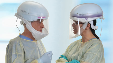 Health care workers wearing powered air-purifying respirators.