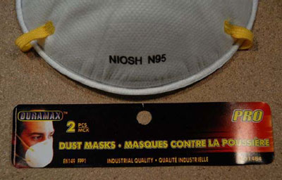 The DuraMax PRO EN149 FPP1 Dust Mask is individually packaged with the words NIOSH N95 printed on the mask