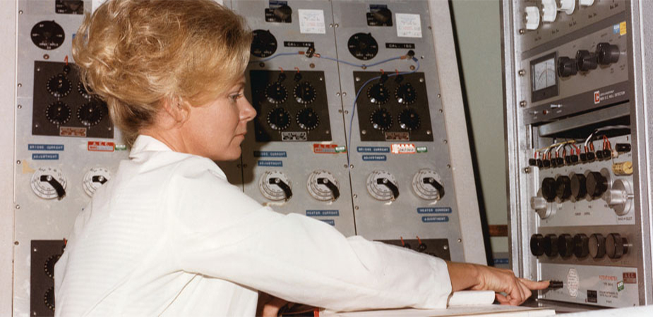 Technician monitors assay of nuclear material (Department of Energy Image Archive)