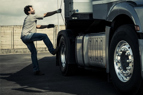 man stepping into a truck