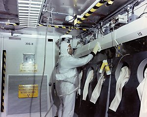 worker wearing full body protective clothing