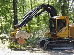 tractor lifting a large tree stump