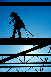 silhouette of a person on a construction site