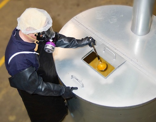 worker retrieving diacetyl from a large cistern