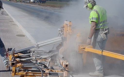 worker performing highway construction