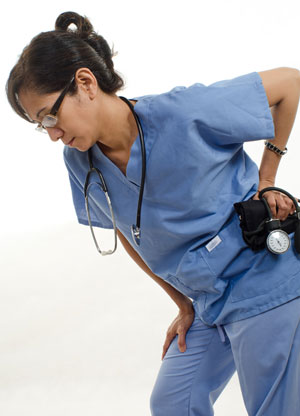 A nurse suffers from lower back pain
