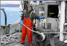 A fishing vessel captain demonstrating the use of an emergency-stop mounted on the winch