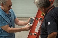 Two workers using the NIOSH ladder safety App