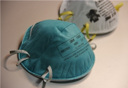 The NIOSH-certified N95 filtering facepiece respirator protects against particulates. Photo from Debora Cartagena, Centers for Disease Control and Prevention.