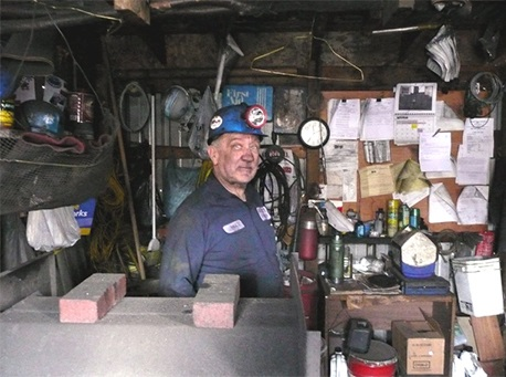 Bill Reiner, a 70-year-old coal miner in Joliett, Pennsylvania, stands in his miner's shanty surrounded by his repertoire of mining paraphernalia in March 2008. Photo by Anita L. Wolfe, CDC/NIOSH