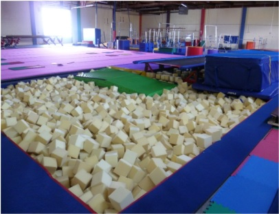 An in-ground pit stocked with replacement foam blocks at one of the four gymnastics studios participating in the study. Photo from NIOSH.