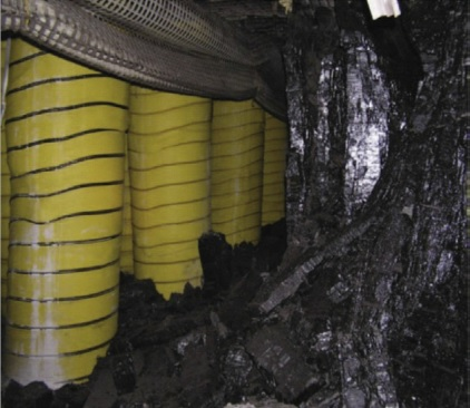 Pumpable roof supports, shown above in an underground coal mine, stabilize the mine roof to prevent collapse during coal removal. Photo from NIOSH.