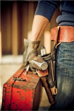 man wearing a tool belt