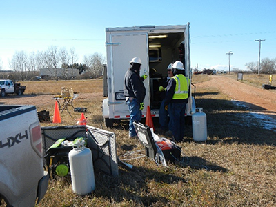 researchers working outside the portable field laboratory