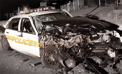 a police cruiser, photographed after being involved in a frontal collision.