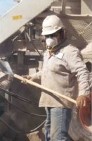 worker wearing particulate respirator