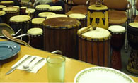 Drums in an event room of a community organization building before a meal and drumming circle event.