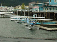 Small commercial float plane docked in marina