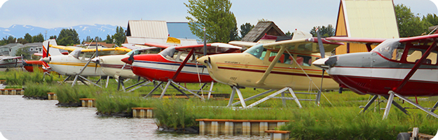 Floatplanes in their slips at Lake Hood in Anchorage, AK.