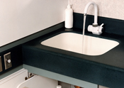 Running sink with anti-bacterial soap on sink