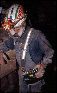 Miner using the NIOSH developed personal dust monitor.