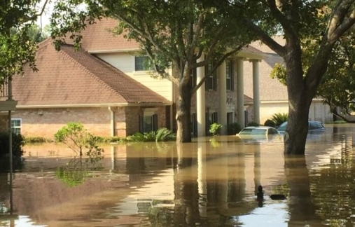 Home with rising flood waters