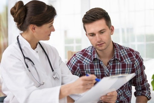 Doctor discussing periodic medical exam with a male patient