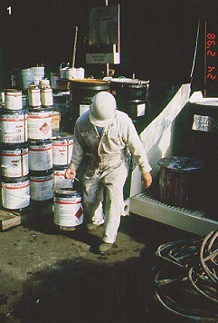 Worker carrying heavy paint cans one-handed