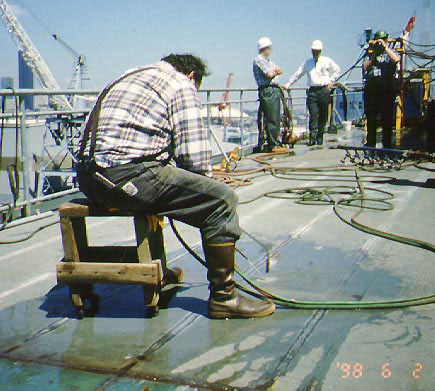 Worker using a wheeled stool