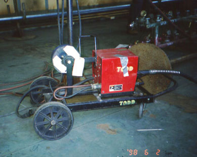Wire welding unit on a wheeled dolly