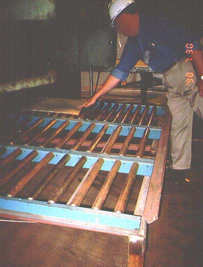 Worker using roller sections at the back of the shear