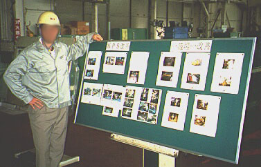 process improvement board, man with pictures