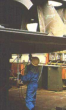 Worker grinding material overhead