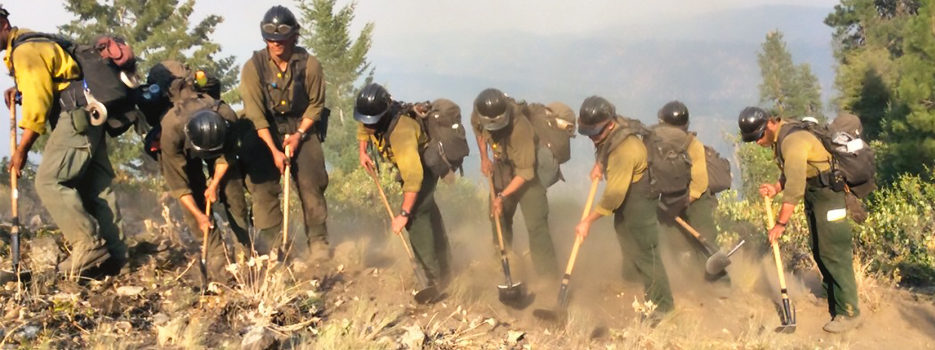 Wildland firefighter Hotshot crew digs fire break along ridge line. Image provided by US Forest Service Technology and Development Program.