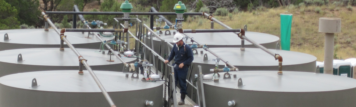 Worker preparing to gauge oil production tanks. Photo credit: NIOSH Western States Division