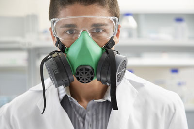 Lab worker wearing a respirator.