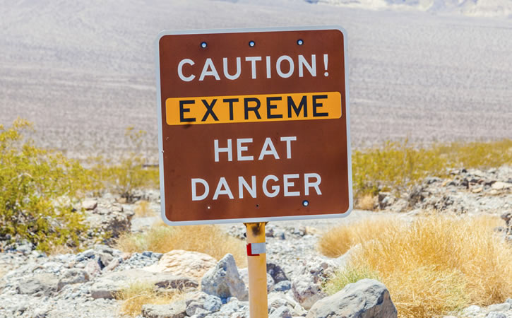 "Sign in desert reads ""Caution! Extreme Heat Danger"""