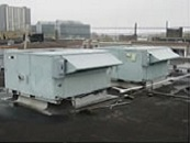 An outdoor building ventilation unit on a rooftop
