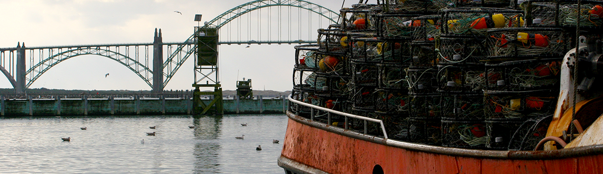 Commercial crabbing vessel's deck is loaded with stacks of crab pots at the start of the fishing season.