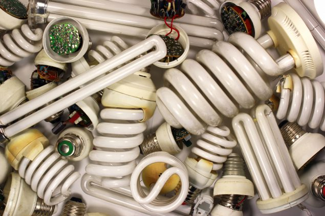 Large pile of florescent bulbs for recycling.
