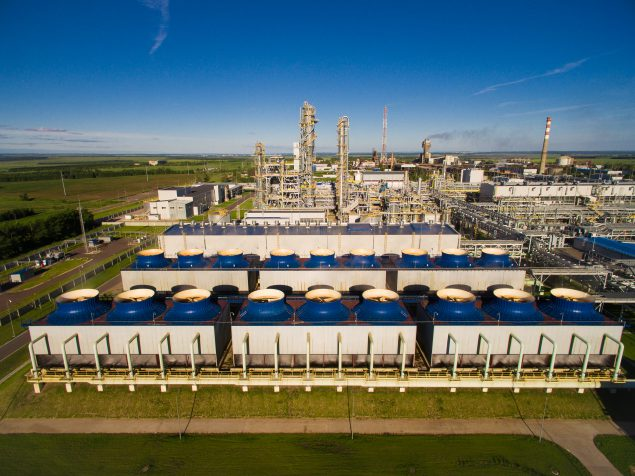 The cooling fans and units for nitric acid production on fertilizer plant. Aerial view Credit: valtron84