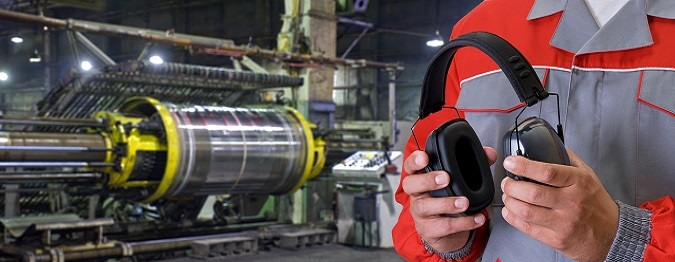 man testing headset in machine warehouse