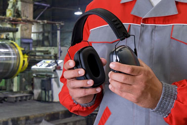 Image showing a factory worker holding a pair of earmuff