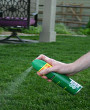 Personal insect repellant being sprayed outside