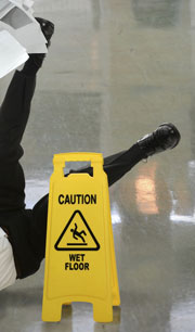Caution, wet floor sign with person falling.